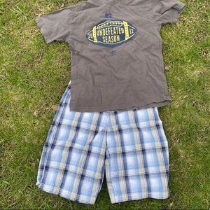Boys t shirt and shorts size L and 14 shorts
